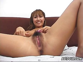Cute Asian chick is playing with a pink toy