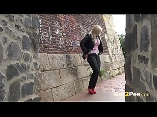 Blonde nearly gets caught wetting her panties in public