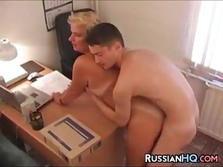 Mature russian boss fucks in her office