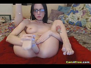 Pretty nerdy babe toying her wet pussy