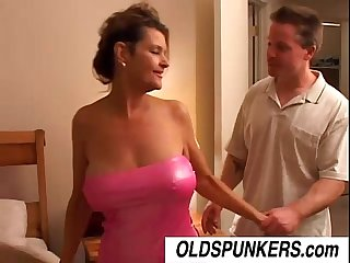 Ravishing raven is a sexy cougar who loves to fuck younger men