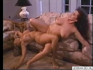 05 Blonde and brunette lesbians suck and rub pussies together on couch2-More on..
