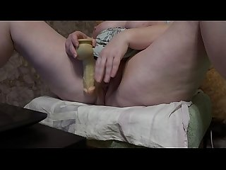 Fat milf with dildo masturbates hairy pussy in front of the webcam and shakes big tits.