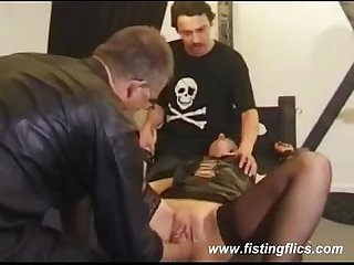 Mature slave fist fucked by two perverts