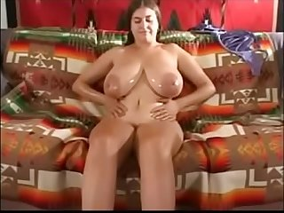 Massive cock between huge breasts