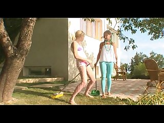 Playful girls using A broom as A dildo