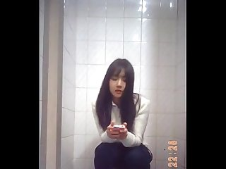 Beautiful chinese girl in toilet