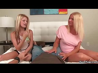 Teen mom and daughter tag team handjob
