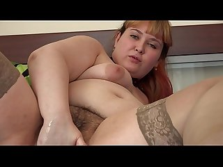 A beautiful BBW shakes her juicy PAWG and makes herself deep vaginal fisting. A homemade..