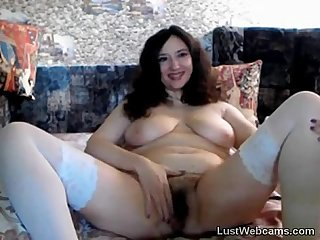 Chubby MILF plays with her hairy pussy on cam