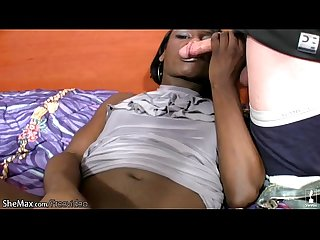 Long haired ebony tranny teases the camera and sucks cock