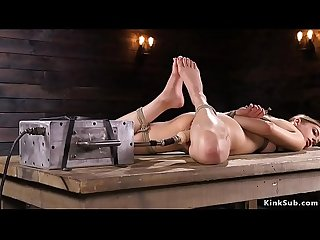 Sexy brunette in rope fucking machine