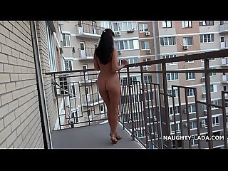 Nude on the public balcony