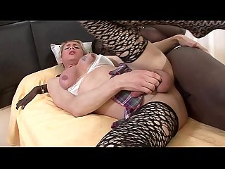 A blonde transsexual plays with a black huge cock