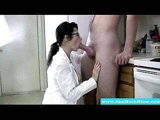 Mature in spex gobbling on hard cock