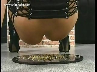 Blond milf slave with her tits tied together got spanked in dungeon by angry master