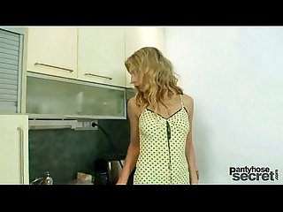 Blonde vanesa masturbates through her blue nylons in kitchen