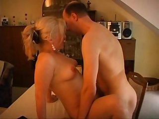 Horny mature couple having fun on the couch