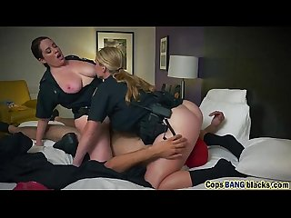 Busty female cops play with tits while getting pussies serviced by black man