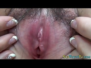 Asian shows off hairy vag