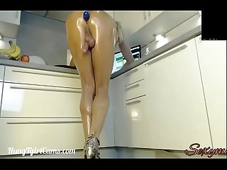 Oiled up shemale showing her cock and ass