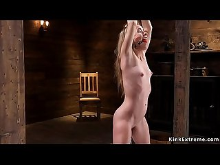 Petite blonde fucks machine in bondage