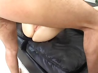 Sexy blonde with nice butt Angela Stone rides cock and gets fucked doggystyle on the leather couch..